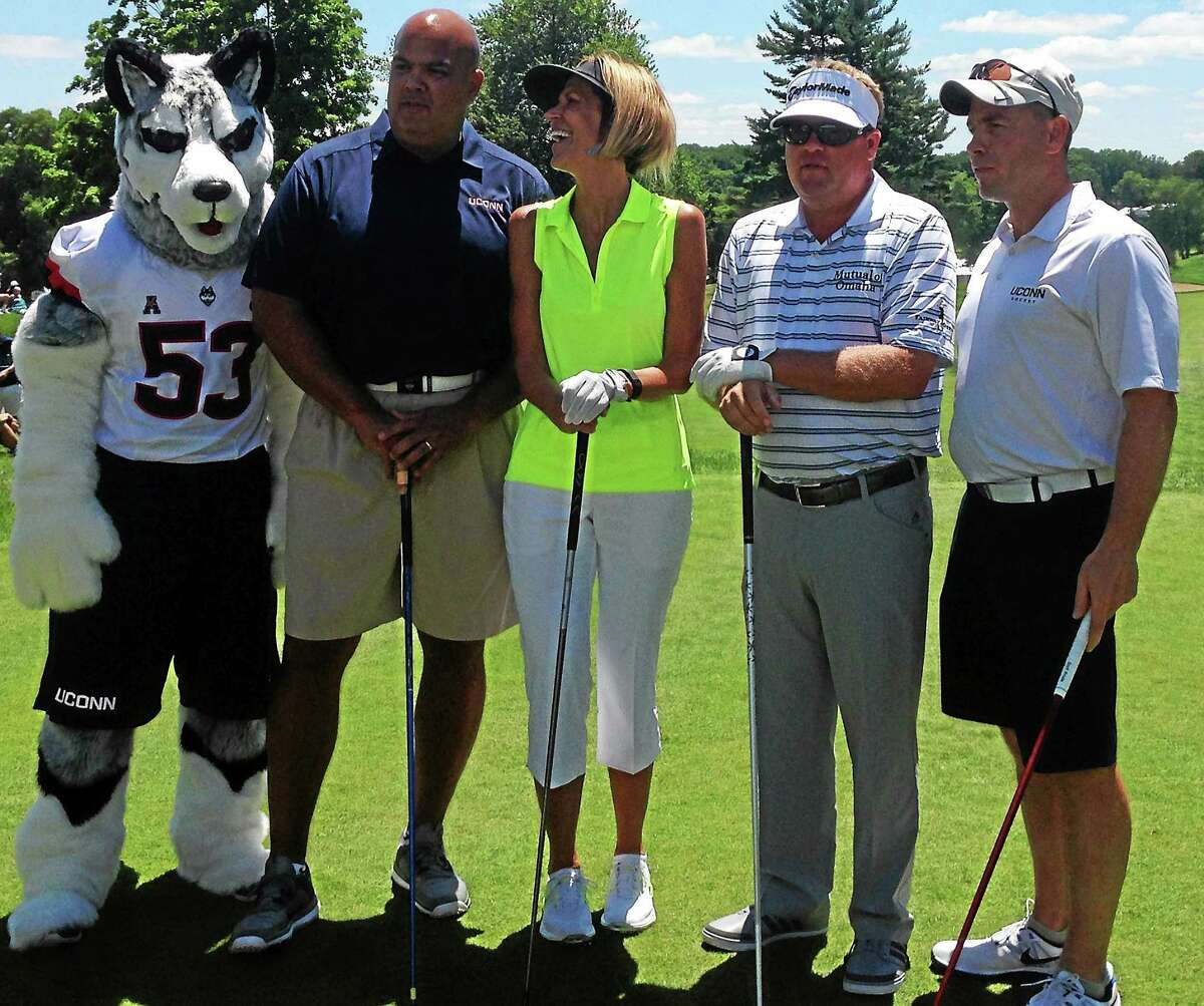 From left, the UConn mascot, AD Warde Manuel, associate women's basketball head coach Chris Dailey, pro Carl Petersson and UConn men's hockey coach Mike Cavanaugh pose before teeing off at Wednesday's Travelers Celebrity Pro-Am.