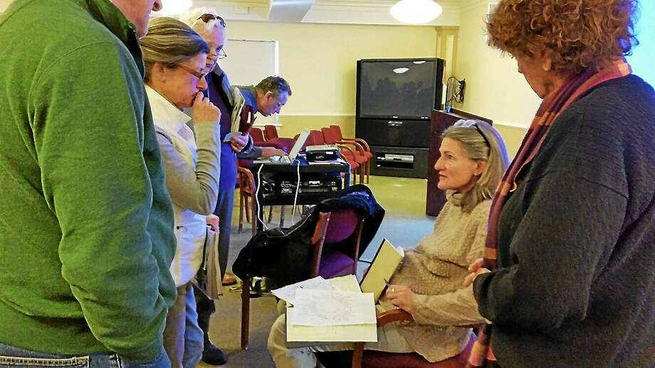 Peggy O'Brien, a board member of Salisbury Family Services, leads a discussion to an audience of 20 people on plans for the upcoming season for the Community Garden on Sunday afternoon at the Scoville Memorial Library in Salisbury. Photo: N.F. Ambery — Special To The Register Citizen