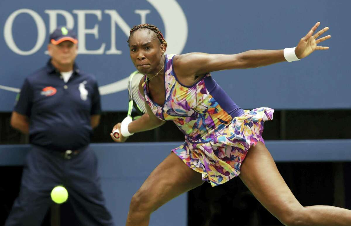 Venus Williams returns a shot to Karolina Pliskova during the fourth round of the U.S. Open Monday. Williams fell in a third-set tiebreaker.