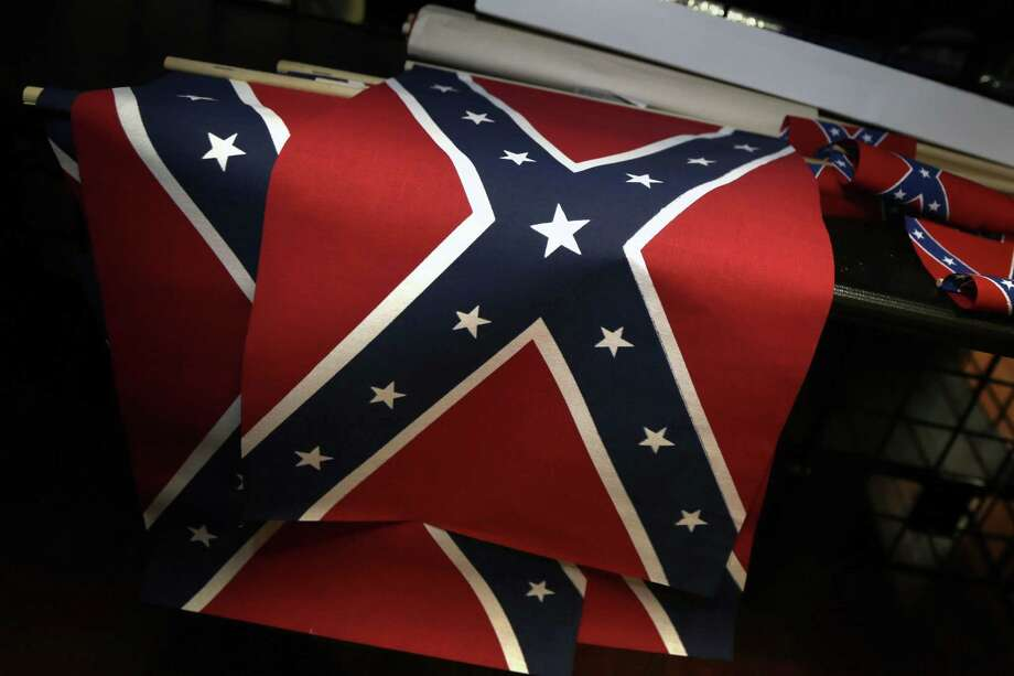 Small Confederate flags are displayed on a shelf at Arkansas Flag and Banner in Little Rock, Ark., Tuesday, June 23, 2015. Major retailers including Amazon, Sears, eBay and Etsy and Wal-Mart Stores Inc., are halting sales of the Confederate flag and related merchandise. (AP Photo/Danny Johnston) Photo: AP / AP