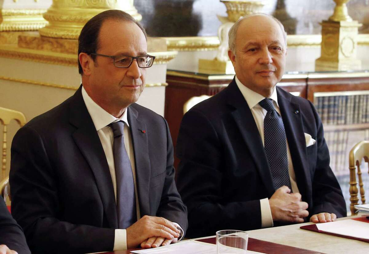 French President Francois Hollande, left, and French Foreign Minister Laurent Fabius chair a meeting at the Elysee Palace in Paris, France, Thursday,June 24, 2015. Appearing more irritated and embarrassed than surprised, France's government summoned the U.S. ambassador Wednesday to respond to Wikileaks revelations that the NSA eavesdropped on three successive presidents and other top officials. (Charles Platiau, Pool via AP)