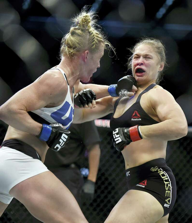 Holly Holm, left, punches Ronda Rousey during their UFC 193 bantamweight title fight in Melbourne, Australia. Photo: The Associated Press File Photo  / AP