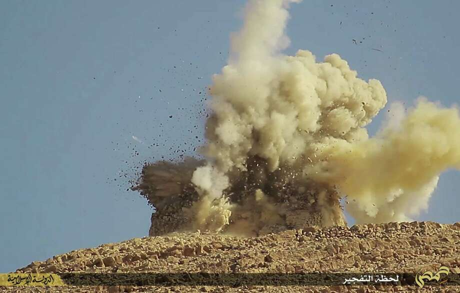 This undated photo released on June 22, 2015, by a militant website, which has been verified and is consistent with other AP reporting, shows one of two mausoleums blowing up by the Islamic State militants, in the historic central town of Palmyra, Syria. A Syrian official says the Islamic State group has destroyed two mausoleums in the historic central town of Palmyra. Maamoun Abdulkarim, the head of the Antiquities and Museums Department in Damascus, tells The Associated Press that one of the tombs belongs to Mohammad Bin Ali, a descendant of Islamís Prophet Muhammadís cousin Imam Ali. (The website of Islamic State militants via AP) Photo: AP / The website of Islamic State