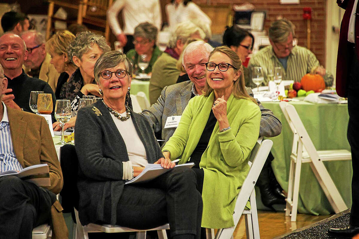 HVA board director Ecton Manning, right, and his wife, Betsy, left, with Marlene Smith, all Washington residents, enjoying the auctioneer's remarks at last year's charity event.