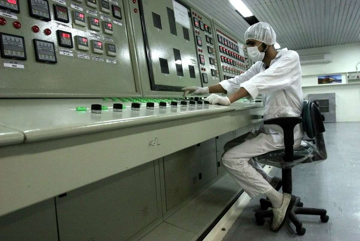 FILE - In this Saturday, Feb. 3, 2007 file photo, an Iranian technician works at the Uranium Conversion Facility just outside the city of Isfahan 255 miles (410 kilometers) south of the capital Tehran, Iran. State TV says the Guardian Council, Iran's constitutional watchdog, ratified a bill Wednesday, June 24, 2015, banning access to military sites and scientists as Tehran and world powers approach a deadline for reaching a comprehensive nuclear deal. The bill would allow for international inspections of Iranian nuclear sites within the framework of the Nuclear Non-proliferation Treaty. (AP Photo/Vahid Salemi, File)