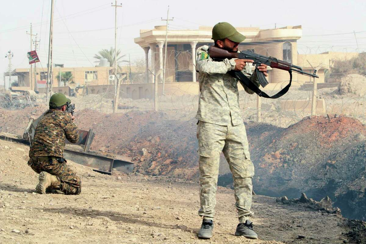 Iraqi security forces and allied Popular Mobilization Forces search Beiji oil refinery, some 250 kilometers (155 miles) north of Baghdad, Iraq, Thursday, Oct. 22, 2015. Coalition officials said that Iraqi security forces, backed by the paramilitary Popular Mobilization Forces and Iraqi federal police, and supported by airstrikes, continue to work to recapture and clear the western city of Ramadi and the city of Beiji, home to Iraq's largest oil refinery.