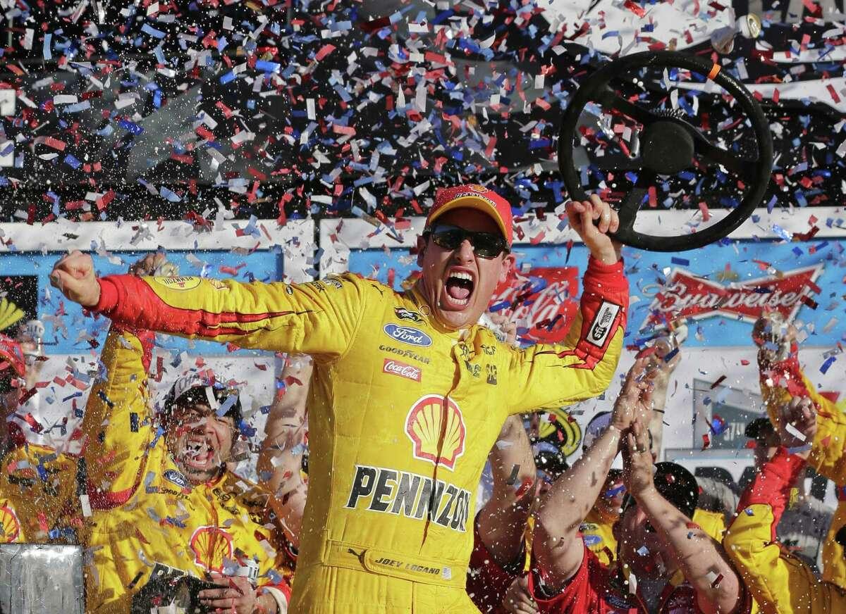 Joey Logano celebrates in Victory Lane after winning the Daytona 500 Sunday in Daytona Beach, Fla.