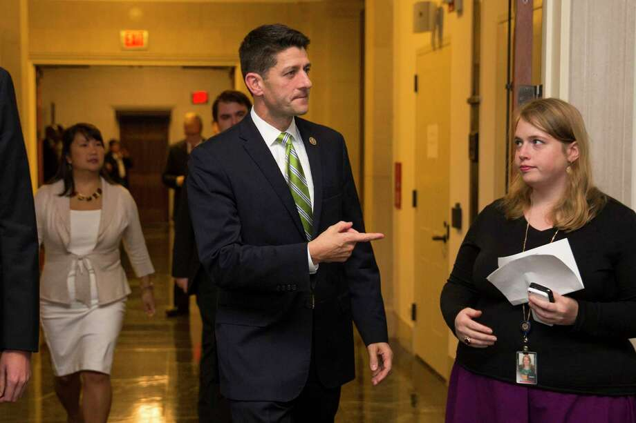 "In this Oct. 8, 2015, file photo, Rep. Paul Ryan, R- Wis. arrives for a meeting on Capitol Hill in Washington. Maybe Ryan doesn't feel like a character in the classic film ""The Godfather"" weighing in an offer he can't refuse. But with Republican party elders practically begging him to become the next House Speaker, the pressure on him to seek the post is immense. Photo: AP Photo/Evan Vucci, File   / AP"