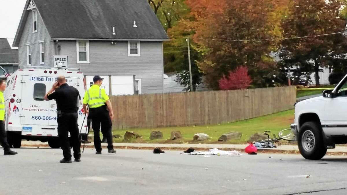 Police investigate a fatal accident at the intersection of East Albert Street and Oak Avenue in Torrington on Thursday afternoon.