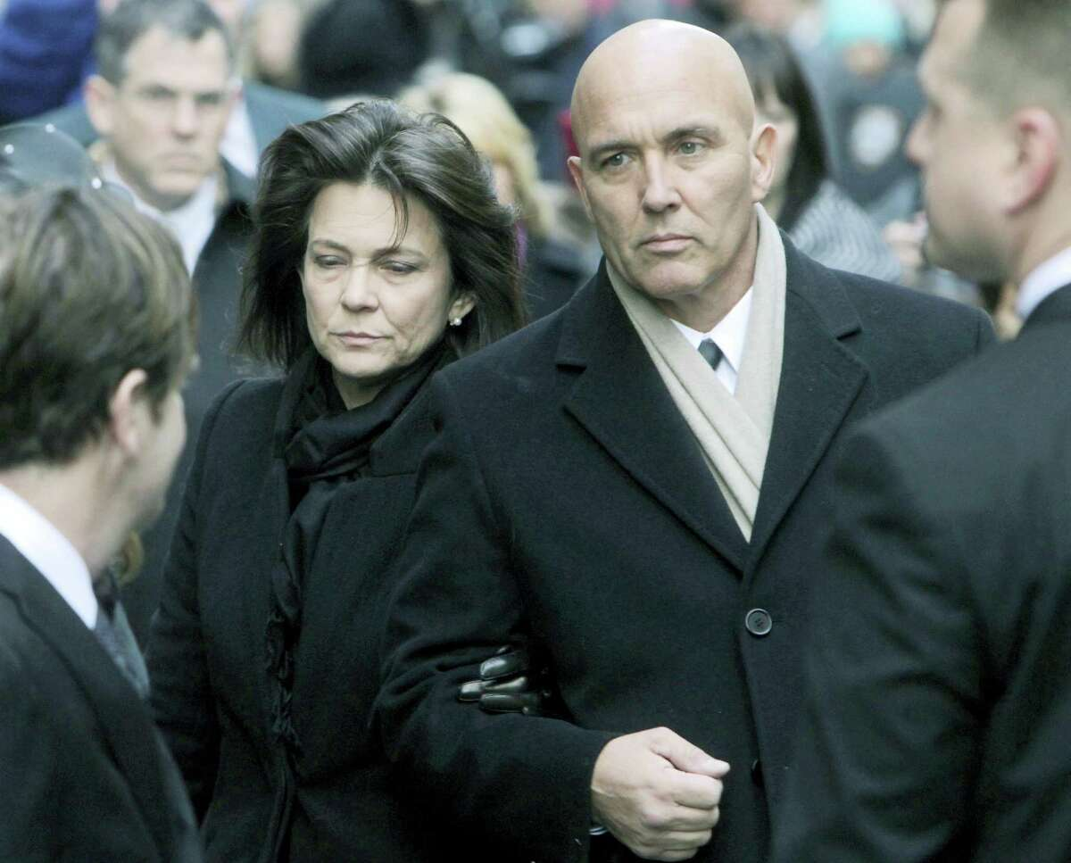 Madonna Badger, left, and Michael Borcina arrive for the funeral of Badger's three children in New York in 2012.
