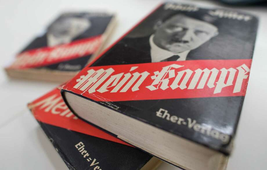 "In this  Dec. 11, 2015 photo, different editions of Adolf Hitler's ""Mein Kampf"" are on display at the Institute for Contemporary History in Munich. For 70 years since the Nazi defeat in World War II, copyright law has been used to prohibit the publication of ""Mein Kampf,"" the notorious anti-Semitic tome in which Hitler set out his ideology, in Germany. That will change in January 2016, when a new edition with critical commentary, the product of several years' work by a publicly funded institute, hits the shelves. Photo: Matthias Balk/dpa Via AP  / dpa"