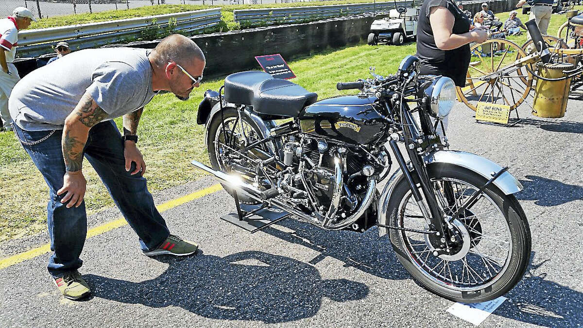 Brian Rose of Lake George, New York, checks out a 1952 Vincent Series C Black Shadow vintage motorcycle restored by David Miller of Ridgefield.