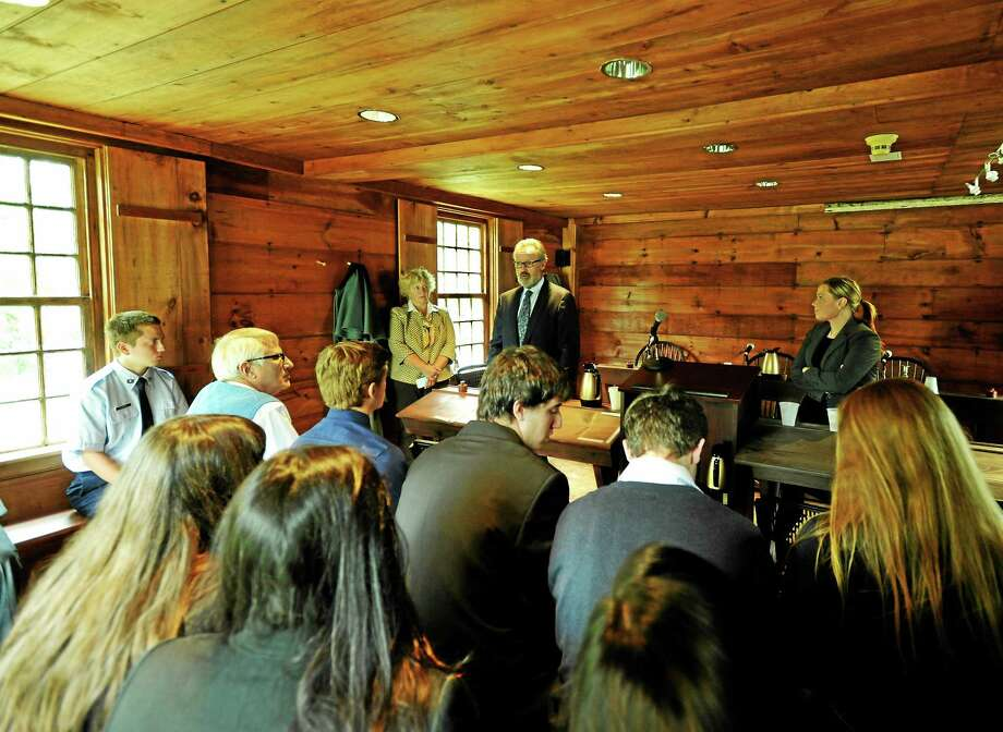 JOHN FITTS — THE REGISTER CITIZEN Attorneys Megan L. Piltzof Sabatini and Associates and Michael D. Neubert of Neubert, Pepe and Monteith talk to students from Northwestern Regional School District No. 7 at the historic Litchfield Law School. Photo: Journal Register Co.