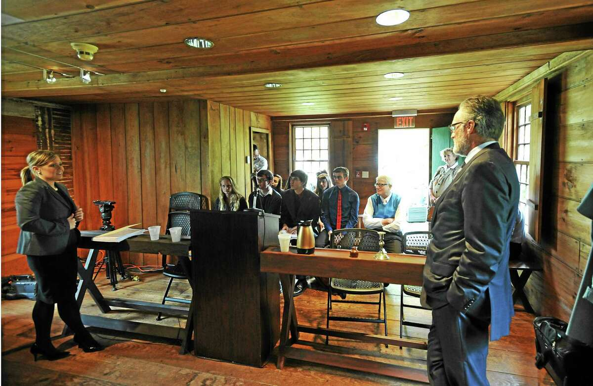 JOHN FITTS — THE REGISTER CITIZEN Attorneys Megan L. Piltzof Sabatini and Associates and Michael D. Neubert of Neubert, Pepe and Monteith talk to students from Northwestern Regional School District No. 7 at the historic Litchfield Law School.