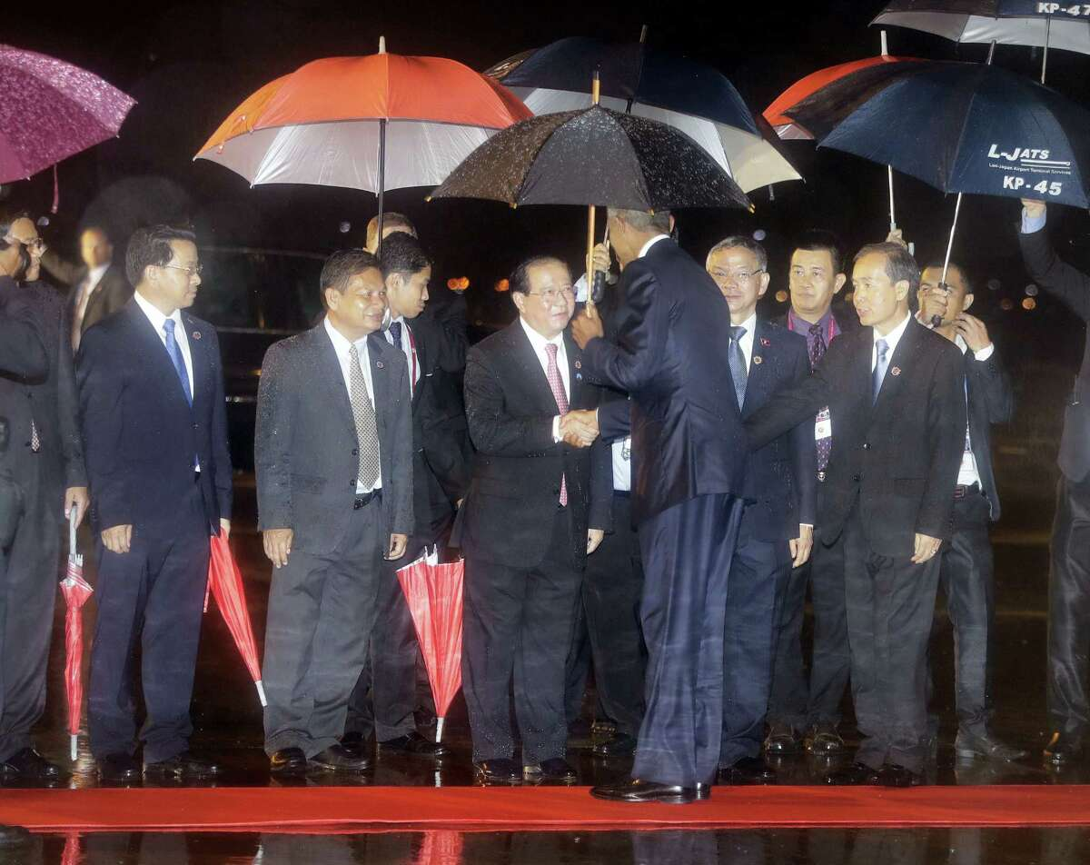 U.S. President Barack Obama is greeted on a red carpet as he arrives on Air Force One to Wattay International Airport in Vientiane, Laos, Monday, Sept. 5, 2016. Obama is the first American president to visit Laos.