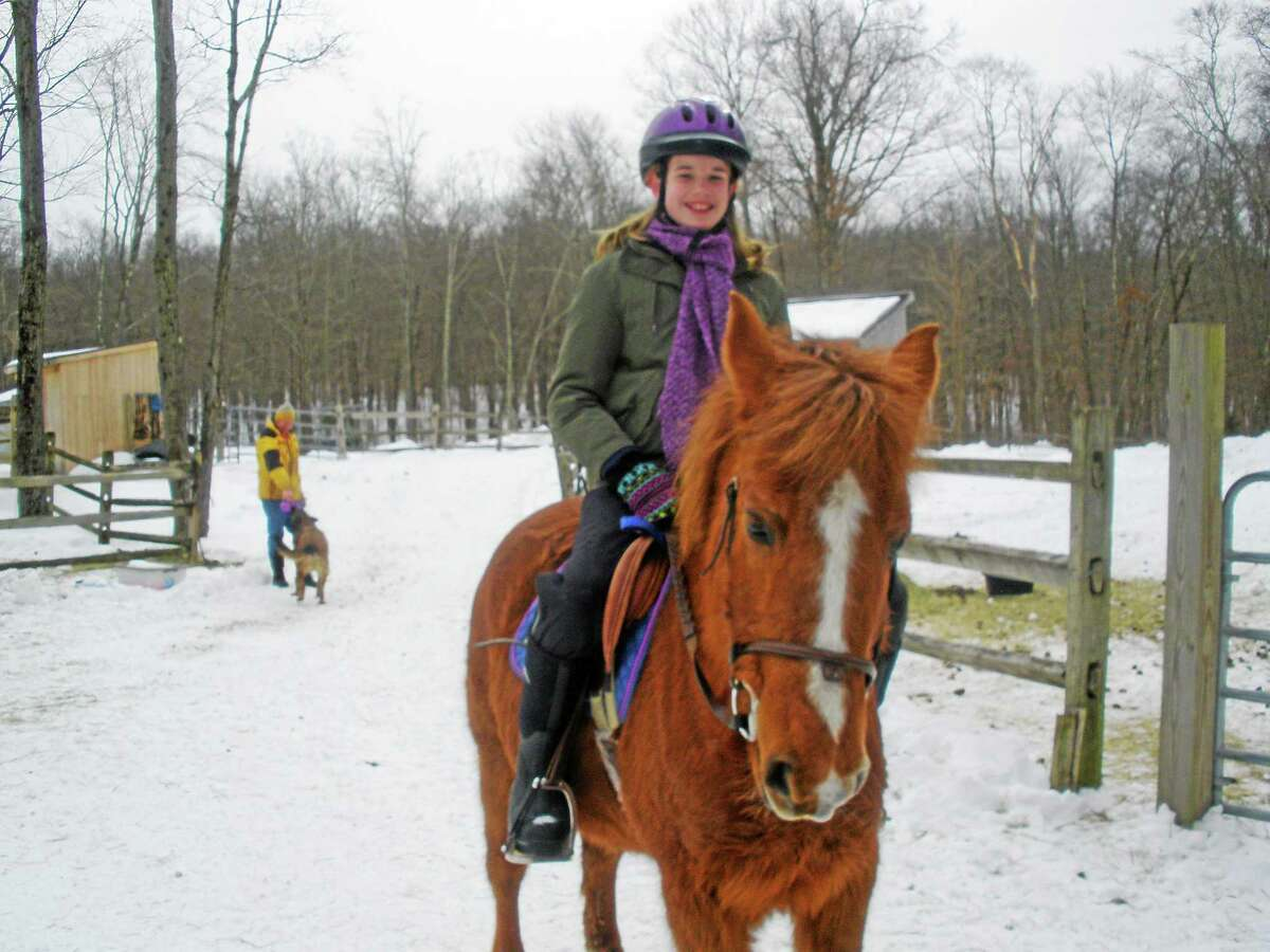Stephen Underwood - Special to The Register Citizen Lillia Kaiser, 11, rides Belle, a Shetland pony recently rescued by H.O.R.S.E. of CT, on the nonprofit's farm in Washington, Conn.