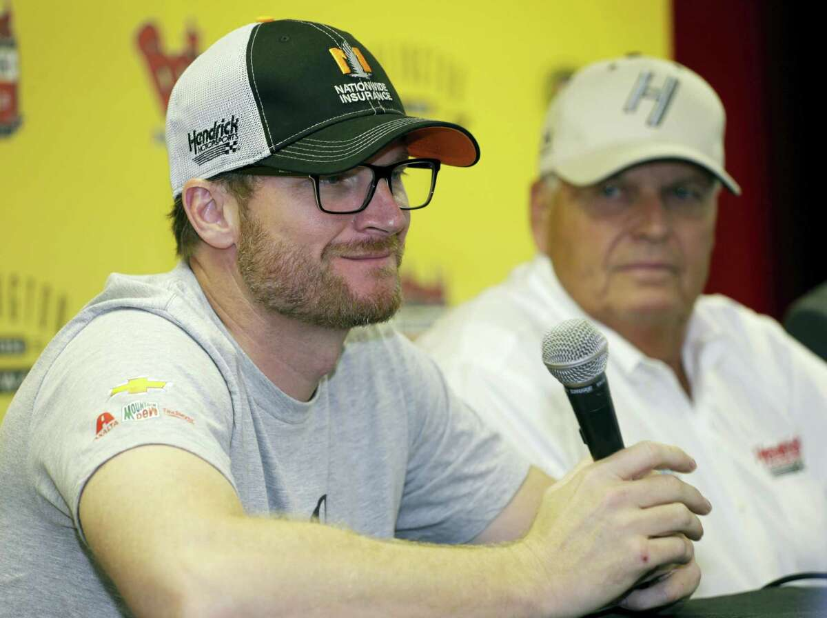 Dale Earnhardt Jr., left, and team owner Rick Hendrick talk to reporters during a news conference Sunday at Darlington Raceway.