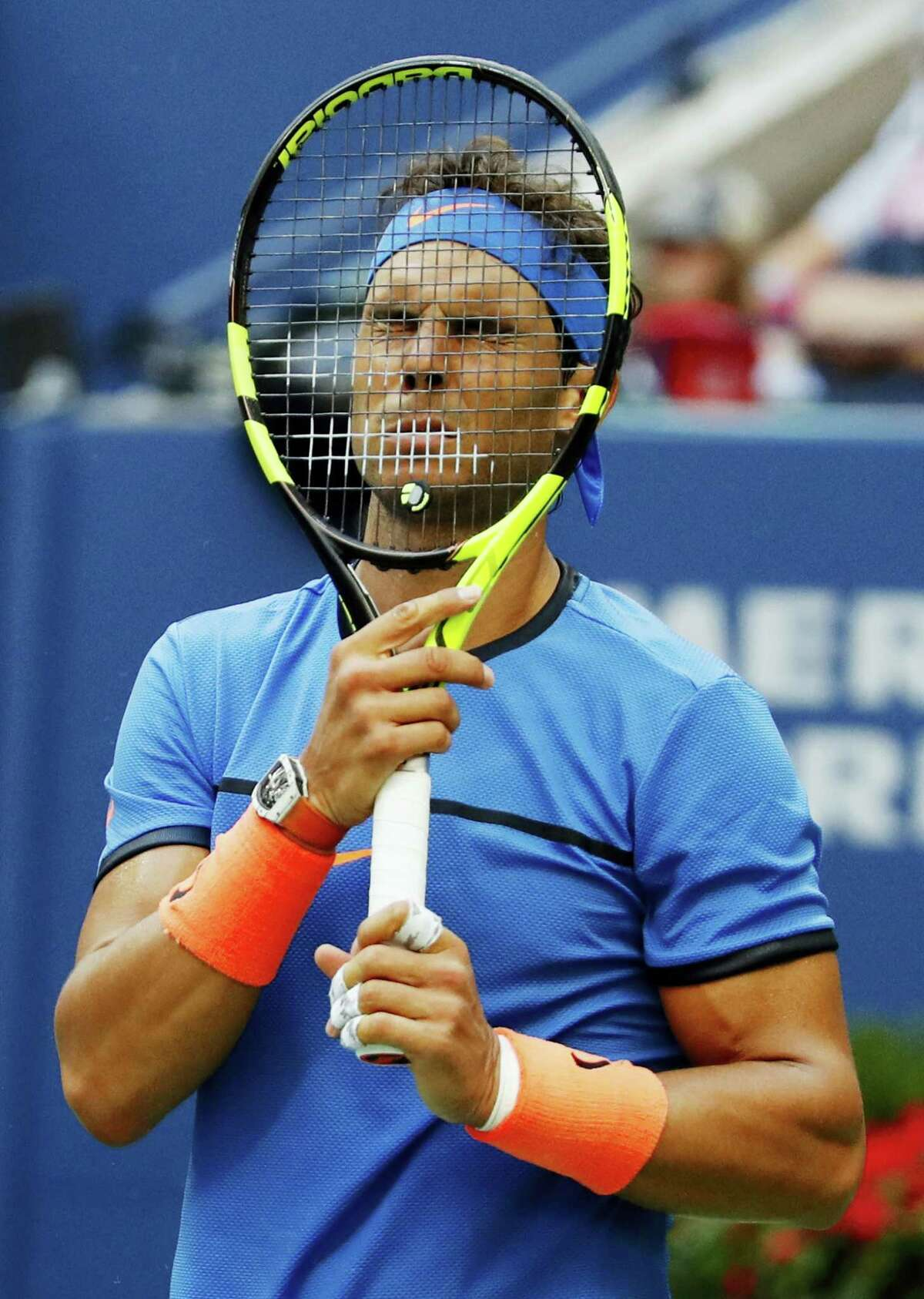 Rafael Nadal puts his racket to his face during his match against Lucas Pouille at the U.S. Open on Sunday.