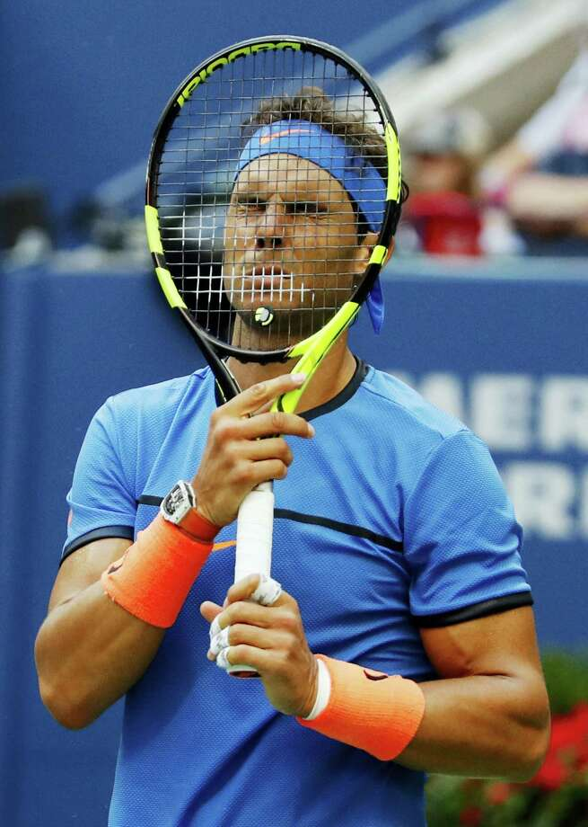 Rafael Nadal puts his racket to his face during his match against Lucas Pouille at the U.S. Open on Sunday. Photo: Alex Brandon — The Associated Press  / Copyright 2016 The Associated Press. All rights reserved.
