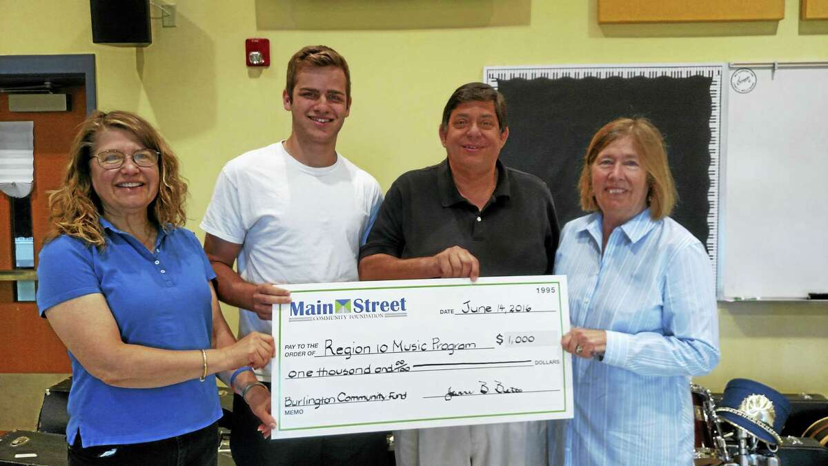 Contributed photo The Burlington Community Fund recently donated $1,000 to Region 10 to refurbish donated musical instruments, providing opportunities to students in the district.