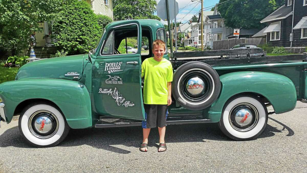 AMANDA WEBSTER — THE REGISTER CITIZEN Nicholas Zubrowski, 9, stands beside one of the vehicles that will be on display at Friday's Main Street Cruise Night.