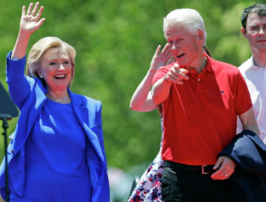In this June 13, 2015 photo, Democratic presidential candidate, former Secretary of State Hillary Rodham Clinton, and her husband, former President Bill Clinton, gesture to supporters on Roosevelt Island in New York. Photo: AP Photo/Frank Franklin II, File  / AP