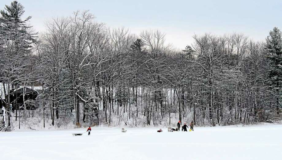 Kids and adults set up at a fishing hole on Mt. Tom Pond. Photo: Journal Register Co.
