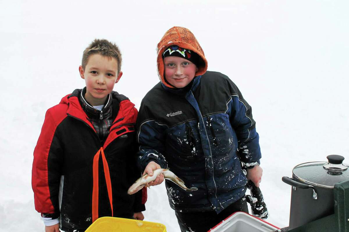 Jason Morrow, left, and Kaden Ashe with a fish caught on Mt. Tom Pond.