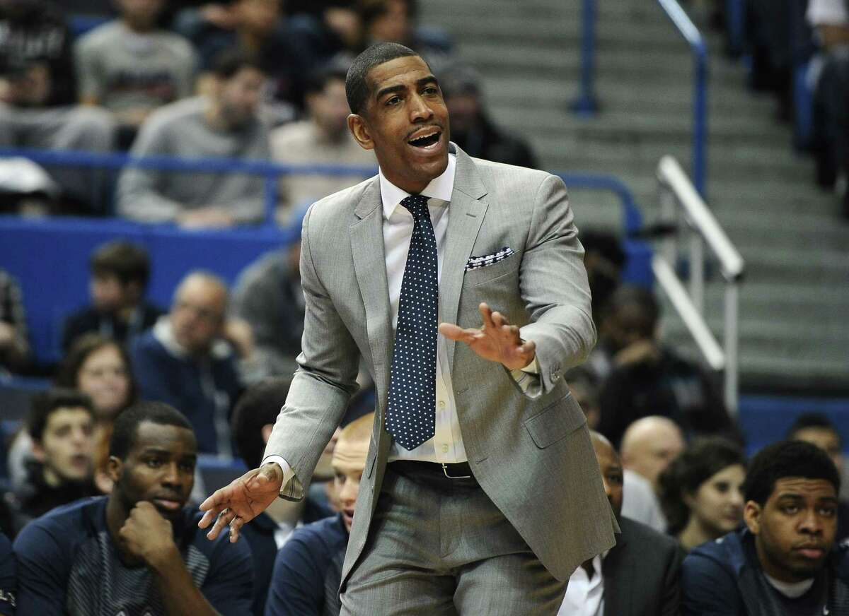 Connecticut head coach Kevin Ollie gestures to his team during the first half of an NCAA college basketball game against SMU, Sunday, March 1, 2015, in Hartford, Conn. UConn won 81-73. (AP Photo/Jessica Hill)