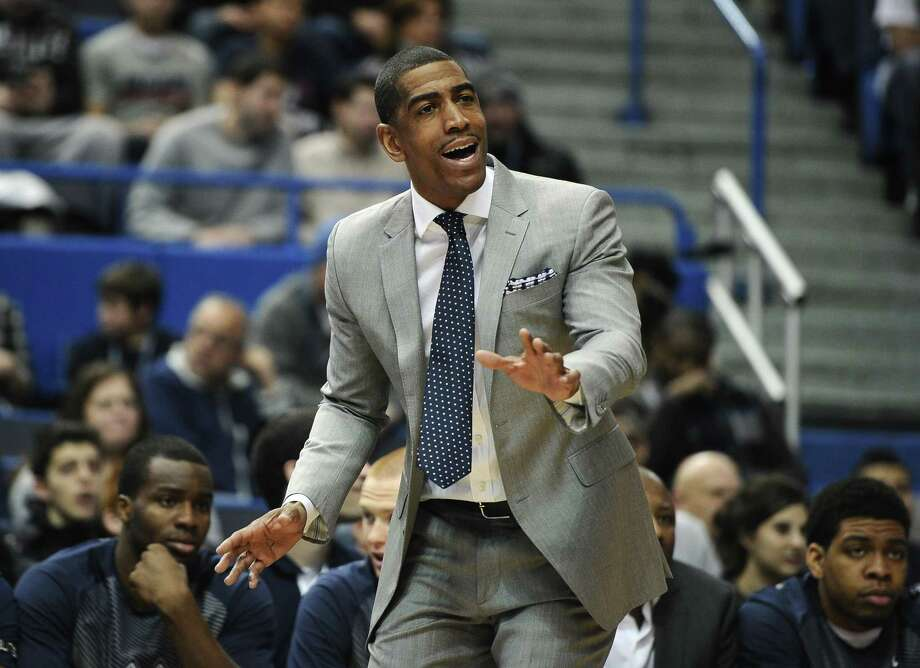Connecticut head coach Kevin Ollie gestures to his team during the first half of an NCAA college basketball game against SMU, Sunday, March 1, 2015, in Hartford, Conn. UConn won 81-73. (AP Photo/Jessica Hill) Photo: AP / FR125654 AP