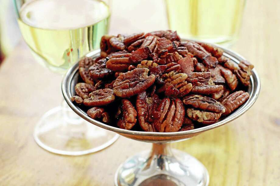 Offer up some spiced bacon pecans at your Oscar party. Once the bacon is nice and crispy, all you have to do is toss in some pecans and a whole mess of seasonings. Photo: Matthew Mead — The Associated Press  / 170582 AP