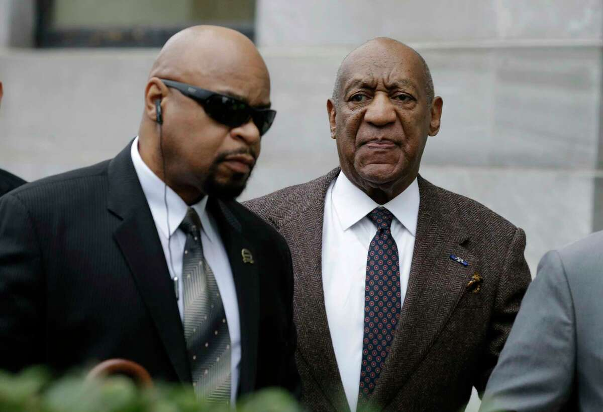 Actor and comedian Bill Cosby, right, arrives for a court appearance Feb. 3, 2016 in Norristown, Pa. Cosby was arrested and charged with drugging and sexually assaulting a woman at his home in January 2004.