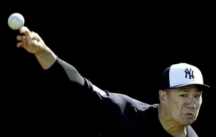 New York Yankees pitcher Masahiro Tanaka throws in the bullpen during a spring training baseball workout Monday. Photo: The Associated Press  / AP