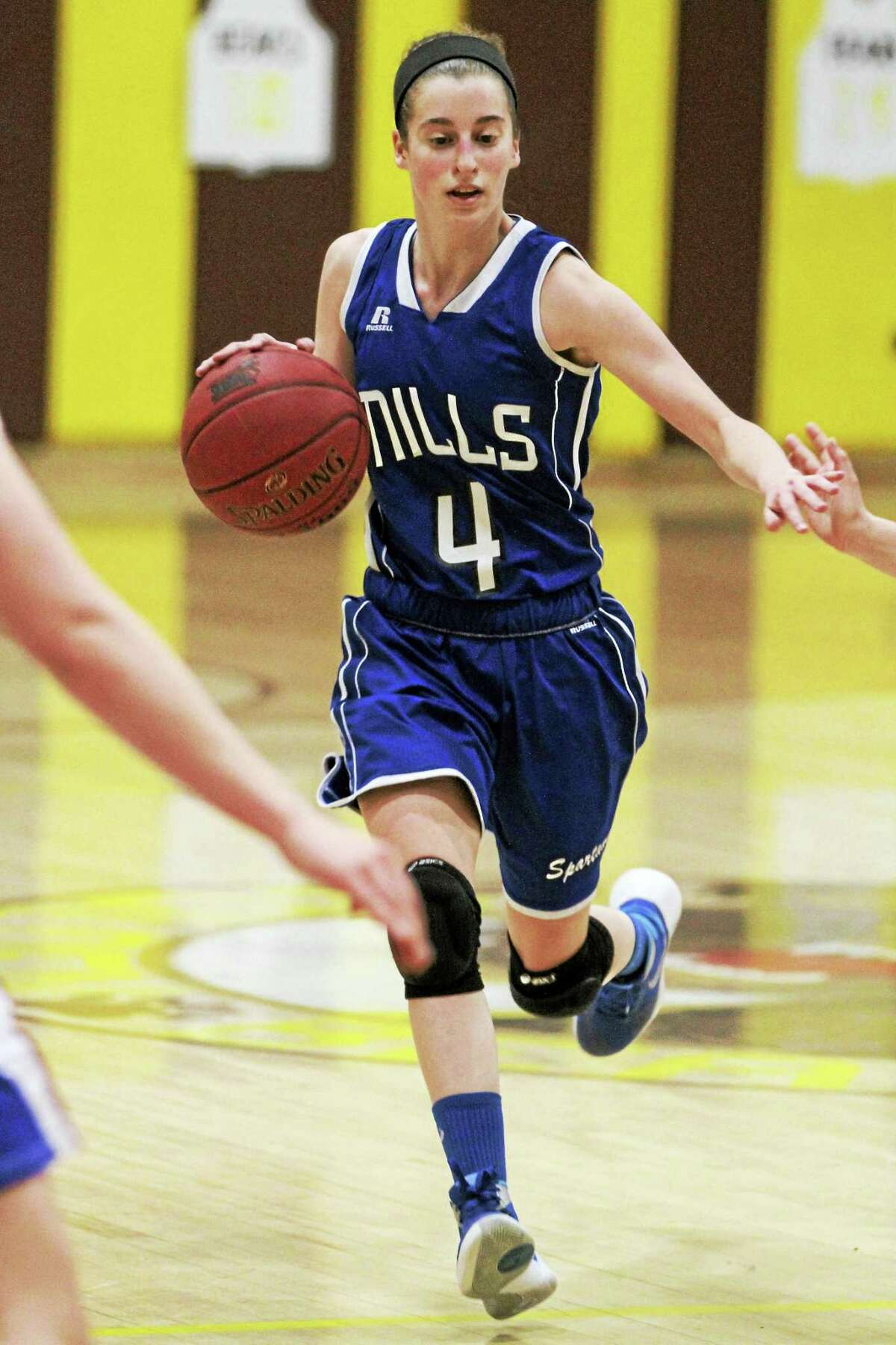 Photo by Marianne KillackeyCorinne Morrow's three first-half 3-pointers carried Lewis Mills to a first-half lead in Monday's Berkshire League Tournament semifinal at Thomaston High School.