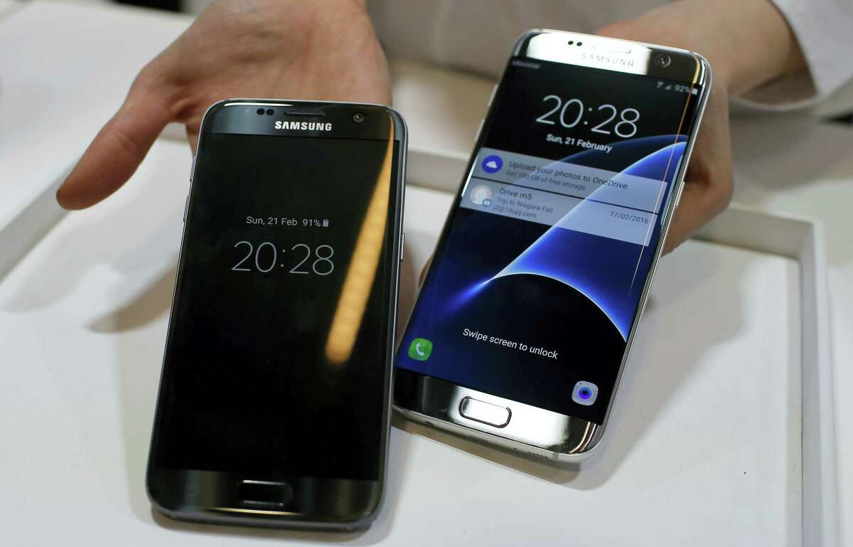 A Samsung Galaxy S7, left, and S7 Edge are displayed during the Samsung Galaxy Unpacked 2016 event on the eve of the Mobile World Congress wireless show, in Barcelona, Spain. Samsung announced Thursday, June 30, 2016, the company will sell unlocked versions of its flagship Galaxy S7 phones in the U.S. so consumers can switch carriers more easily.
