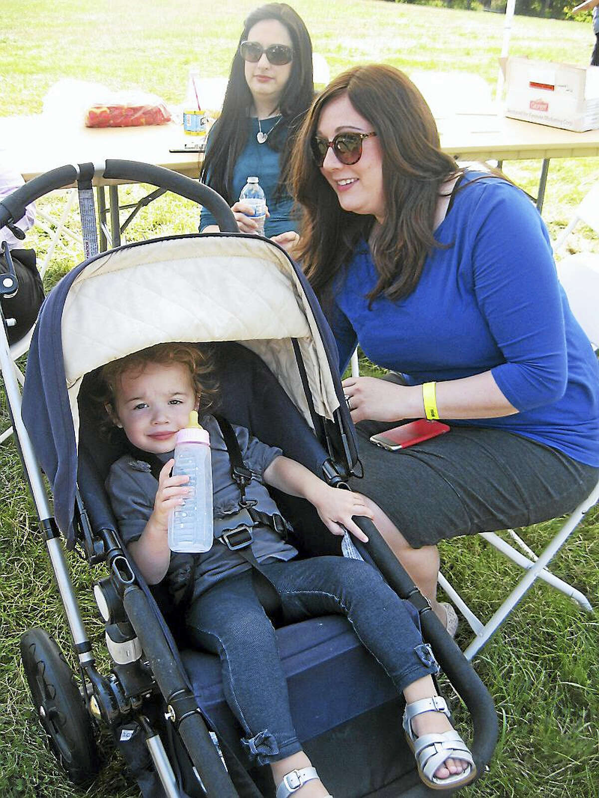 Little Sheva Kahan and her mom Liebo Kahn attended the Jewishfest Sunday.Photo by John Torsiello