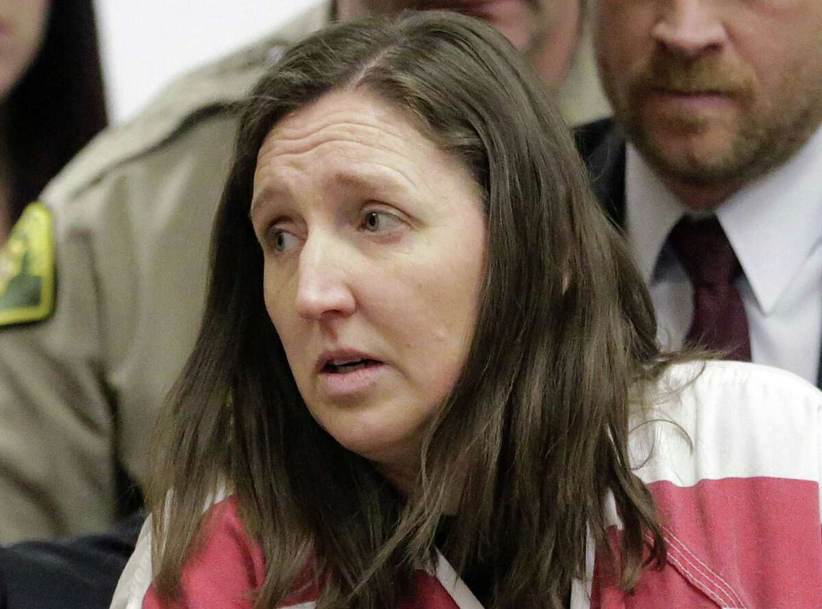FILE - In this Feb. 12, 2015, file photo, Megan Huntsman arrives in court in Provo, Utah. Under intense questioning from detectives after the April 2014 discovery that Huntsman killed six of their babies and stored them in their garage in Pleasant Grove, Utah, Darren West repeatedly denied knowing of his wifeís shocking actions, according to transcripts of police interviews obtained through a public records request. (AP Photo/Rick Bowmer, Pool, File)