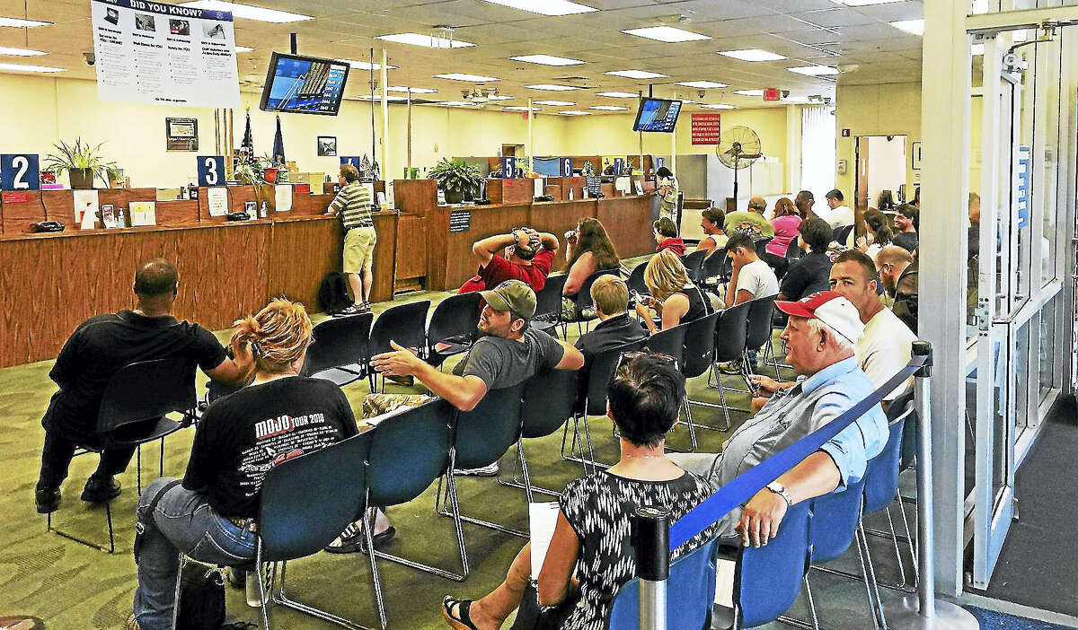 Lines were long at the Winsted DMV in August after the office re-opened alongside others statewide following a computer upgrade. Now an agency computer glitch could complicate local budgeting.