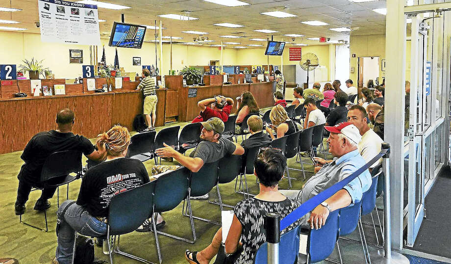Lines were long at the Winsted DMV in August after the office re-opened alongside others statewide following a computer upgrade. Now an agency computer glitch could complicate local budgeting. Photo: Ben Lambert — The Register Citizen