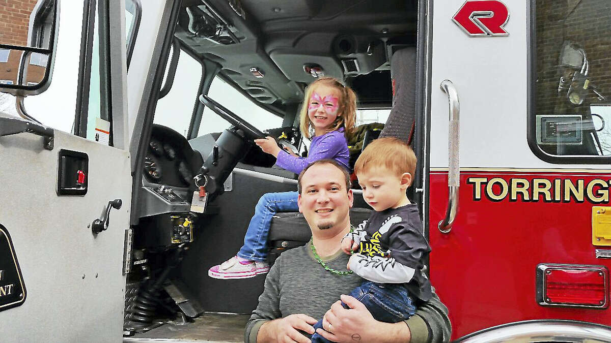 Kyle Fields of Torrington and his children Harper, 4, and Hudson, 2, were introduced to a fire truck by the Torrington Fire Company's Engine 4 firefighters at the KidsPlay Children's Museum's second annual Family Fun Fair.