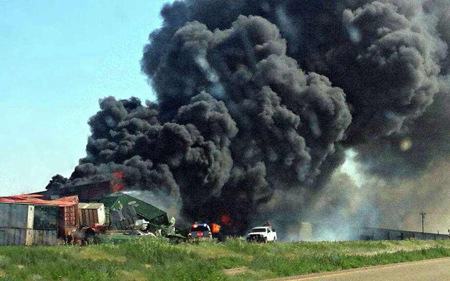 Smoke rises from two cargo trains that collided two miles east of Goodwell, Okla., on June 24, 2012. Photo: AP File Photo  / The Guymon Daily Herald
