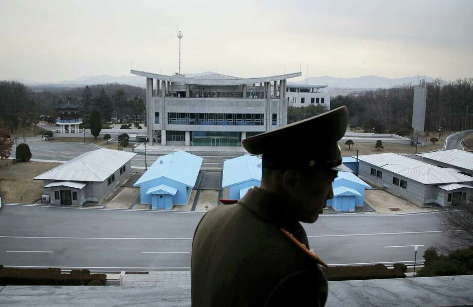 Korean People's Army Lt. Col. Nam Dong Ho is silhouetted against the truce village of Panmunjom at the Demilitarized Zone (DMZ) which separates the two Koreas on Feb. 22, 2016, in Panmunjom, North Korea. Nam Dong Ho told The Associated Press that tensions have increased significantly along the Demilitarized Zone since North Korea conducted its nuclear test and rocket launch. Photo: AP Photo/Wong Maye-E  / AP