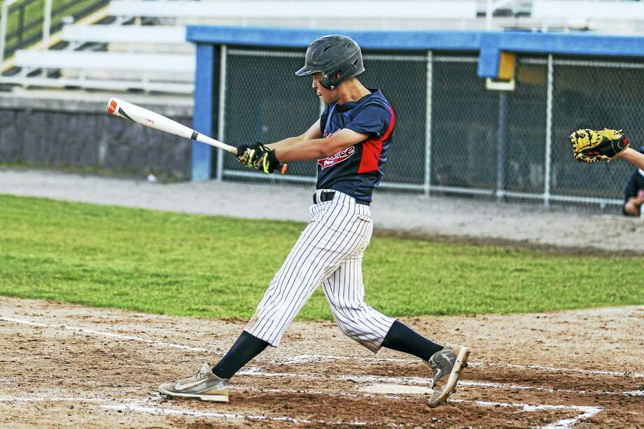 Torrington's D.J. Reynolds' RBI single helped Sports Palace recover from an early 4-0 deficit against Terryville Connie Mack Wednesday at Fuessenich Park. Photo: Photo By Marianne Killackey  / 2015