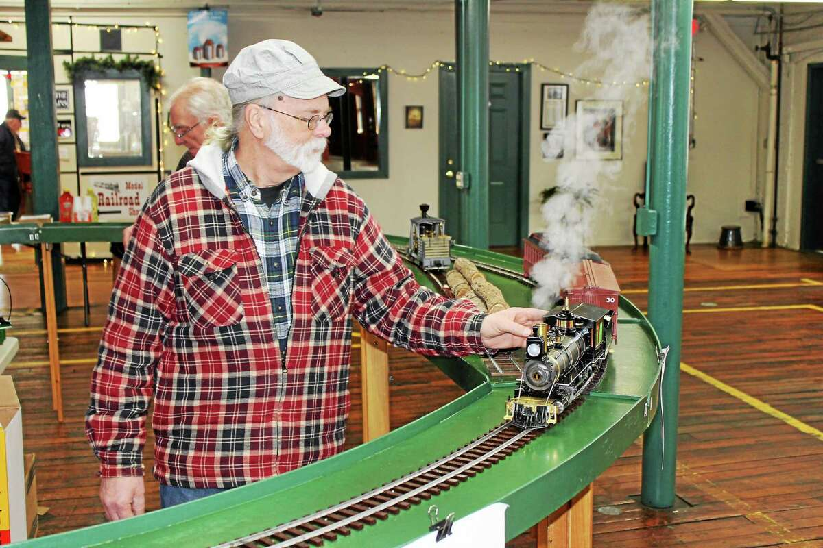 Chester Louis from Granby, Mass., works the track at a train show at Whiting Mills in Winsted on Saturday.