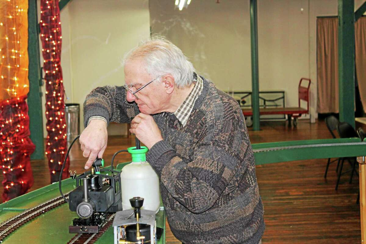Harvey Campbell of Collinsville works with a steam train during an exhibit in Winsted on Saturday.