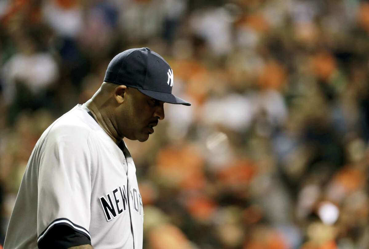 Yankees starting pitcher CC Sabathia walks off the field at the end of the sixth inning.