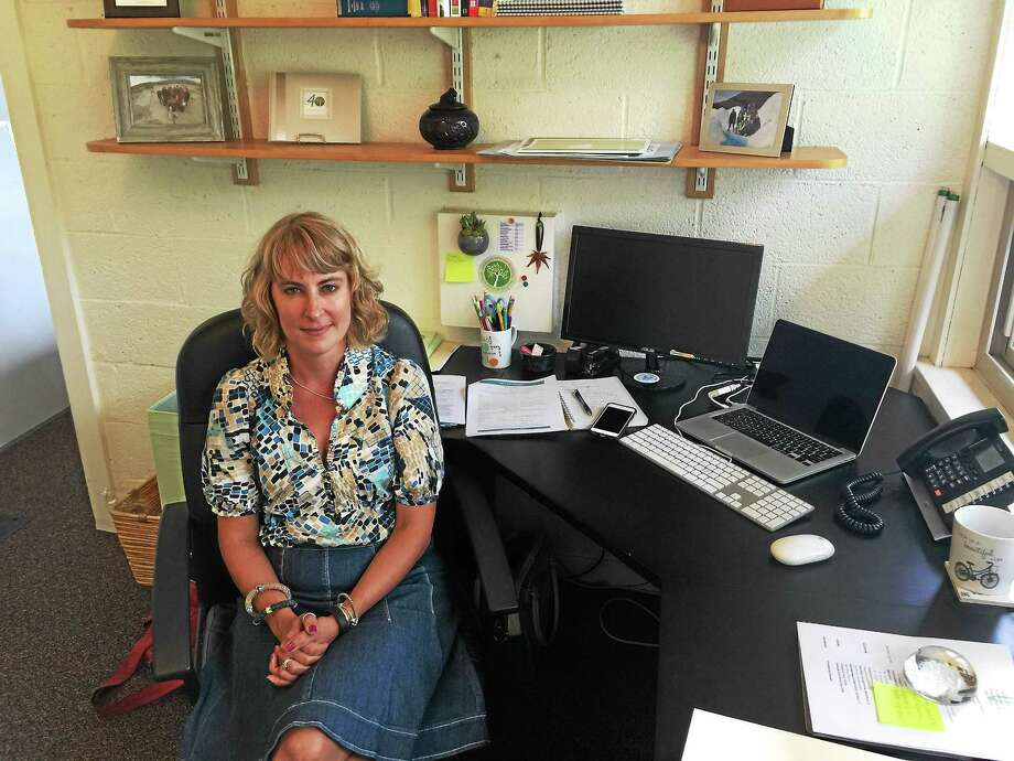 BEN LAMBERT — THE REGISTER CITIZEN Cara Roure Johnson, the new head of the Litchfield Montessori School, at her desk. Photo: Journal Register Co.