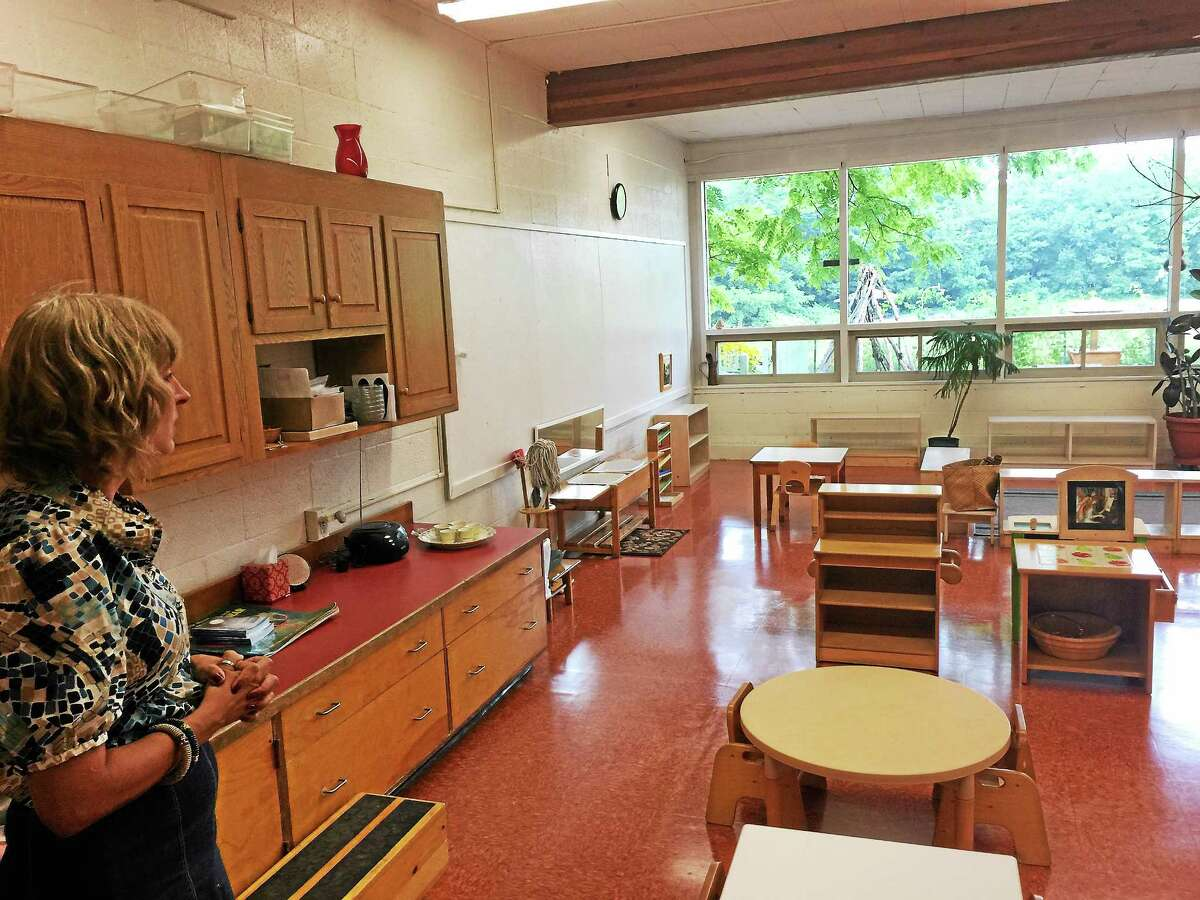BEN LAMBERT — THE REGISTER CITIZEN Cara Roure Johnson shows a classroom at the Litchfield Montessori School.