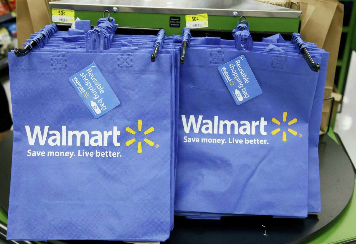 In this, Sept. 19, 2013 photo, reusable shopping bags are offered for sale at a Wal-Mart Neighborhood Market, in the Chinatown district of Los Angeles.