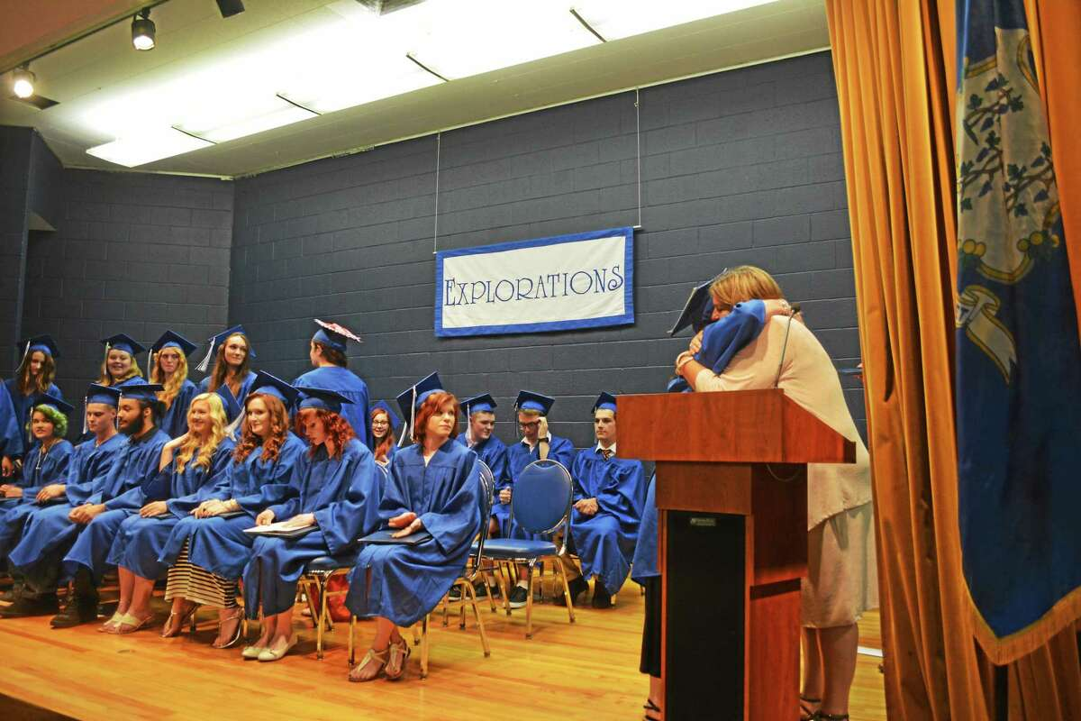 Each graduate of the Explorations Charter School Class of 2015 received a diploma — and a hug — from Principal Jill Johnson Tuesday evening in a commencement ceremony on the UConn-Torrington campus.